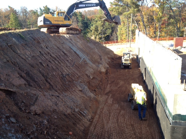 Crews are backfilling and compacting the lower level walls of a commercial project  in Asheville, N.C.