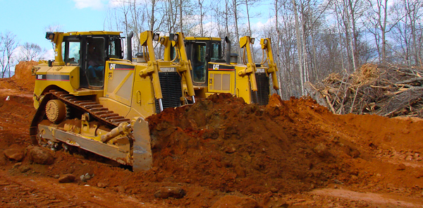 Skilled operators and 87 tons of bulldozers working side by side.