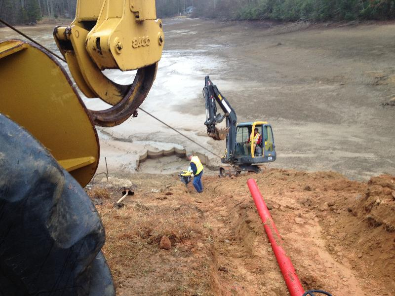 This crew is installing a permanent siphon drain in a lake near Brevard, N.C.