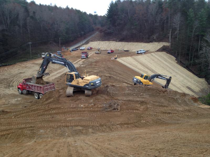 Whitmire Grading's excavator and trucks are exporting excess material off site while other phases of the project are carried out.